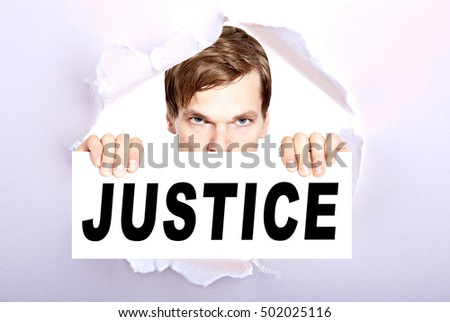 man holding sign with the word justice - torn ripped paper background