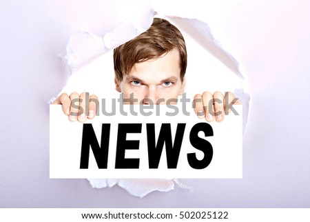man holding sign with the word news - torn ripped paper background