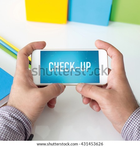 Man holding smartphone which displaying Check-Up - stock photo