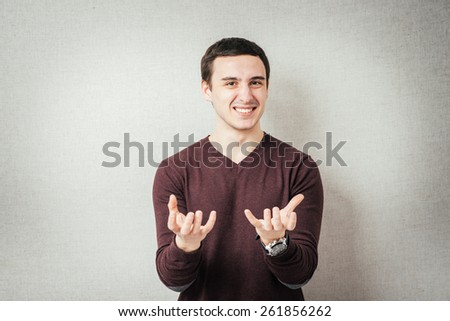 man holding something invisible in the hands of - stock photo