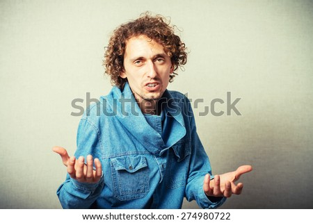 man holding something on his palm. - stock photo