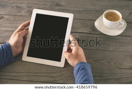 Man holding tablet with blank screen closeup