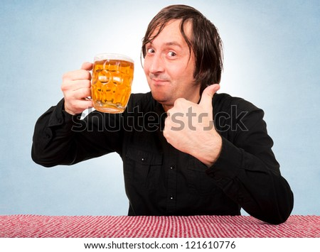 Man holding the beer pint and showing the ok sign - stock photo