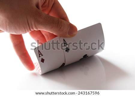Man holding two aces in hand - stock photo
