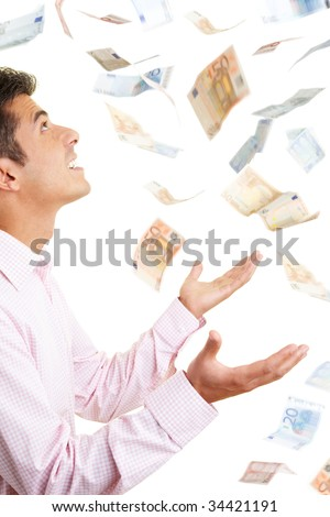 Man holding up his hands for money falling from the sky
