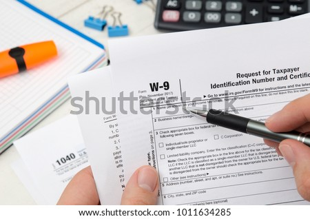Man Holding Us Tax Form W9 Stock Photo 1011634285 Shutterstock