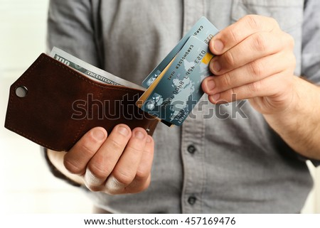 Man holding wallet with credit cards, closeup
