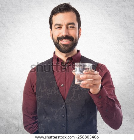 Man holding water glass - stock photo