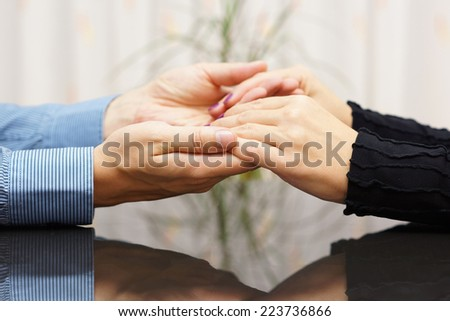 man  holding woman hands. love and care concept - stock photo