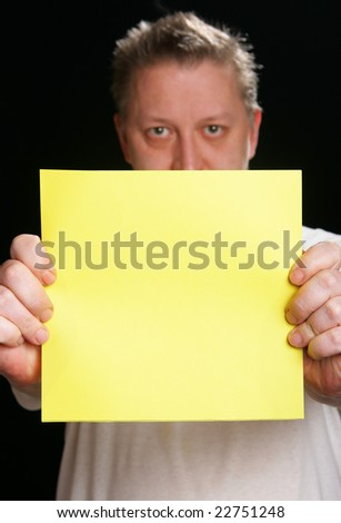 Man holding yellow blank cardboard, put your own text here - stock photo