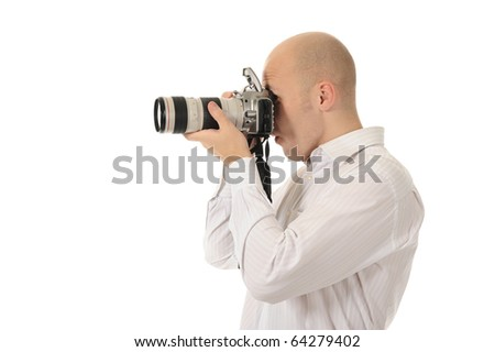 man holds a camera in his hands. Isolated on white background - stock photo