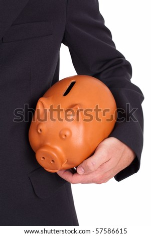 Man holds a piggy bank - stock photo