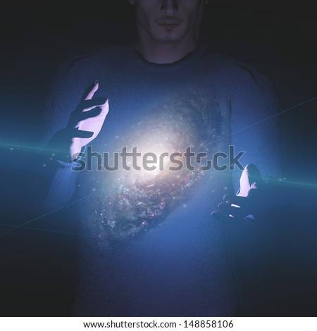 Man holds galaxy between his hands elements furnished by NASA - stock photo