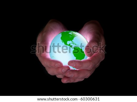 Man holds glowing Earth against black background. Earth image public domain courtesy http://nasa.gov/ - stock photo