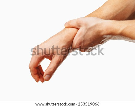 Man holds his hand, acute pain in a wrist. On a white background - stock photo