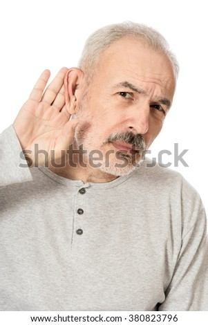 Man holds his hand near his ear and listening something - stock photo
