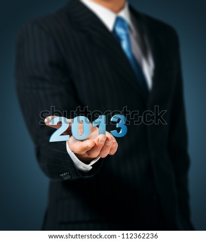Man holds 2013 numbers. - stock photo