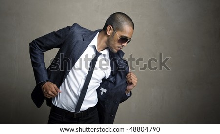 Man holds onto his new sharp suit - stock photo