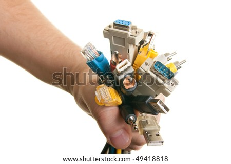 man holds the cables in his hand - stock photo