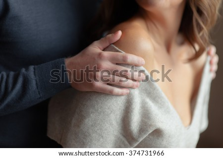 Man holds woman by shoulders