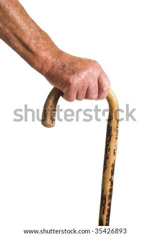 Man holMan wooden walking stick - stock photo