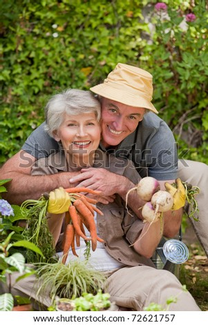 Man hugging his woman in the garden - stock photo
