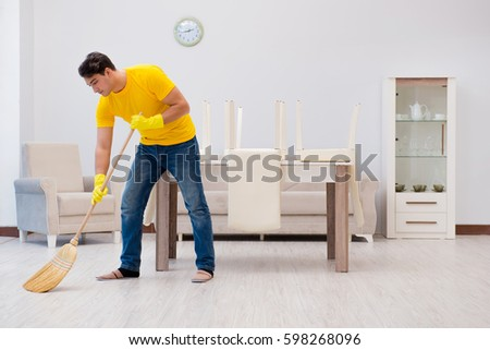 Cleaning The House man husband cleaning house helping his stock photo 598268132