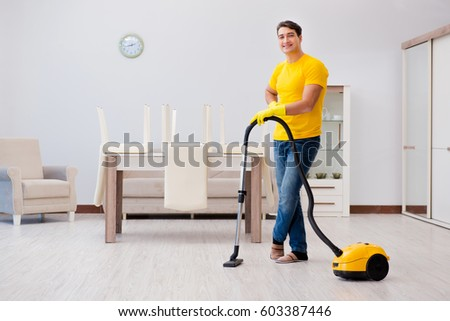 Cleaning The House man husband cleaning house helping wife stock photo 552229663