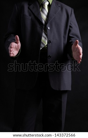 man in a black dress shirt and a tie - stock photo