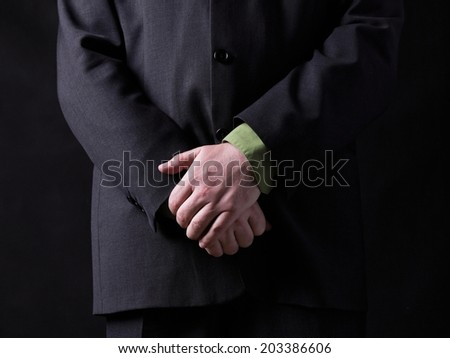 man in a black suit   - stock photo