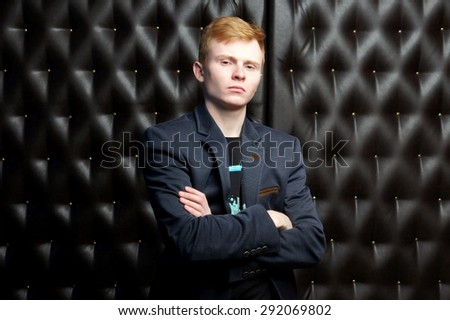 man in a black suit.isolated portrait - stock photo