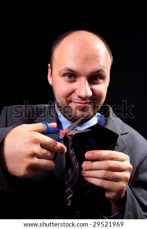 man in a business suit scissors the tie