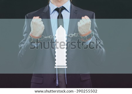 man in a business suit with chained hands. handcuffs for sex games. concept of erotic entertainment. - stock photo