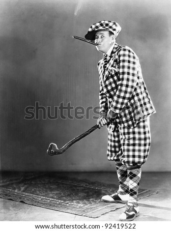 Man in a checkered golf outfit - stock photo