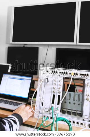Man in a control center - stock photo