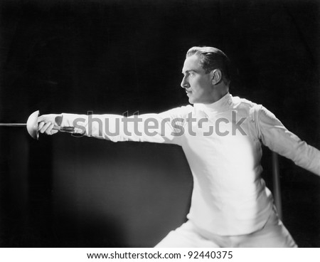 Man in a fencing position - stock photo