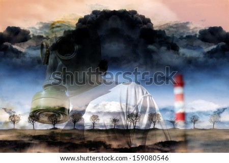 Man in a gas mask against a pipe polluting air - stock photo