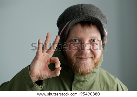 Man in a hat shows that he has all the great