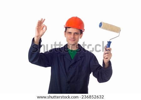 man in a helmet and  blue robe holding roller for painting, show OK