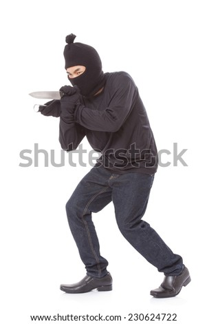 Man in a mask holding flashlight with a knife on a white background  - stock photo