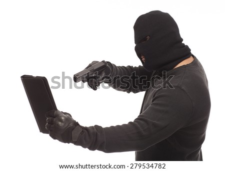 Man in a mask with a gun and digital tablet on a white background. - stock photo