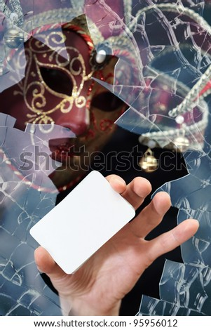 Man in a mask with card , place your image on card. - stock photo