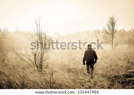 Man in a misty landscape - stock photo