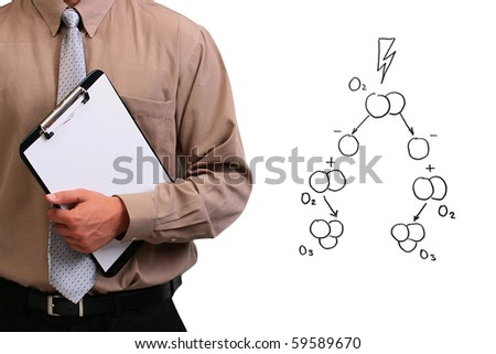 Man in a shirt and a tie holding a clipboard while standing next to a drawing of ozone formation. - stock photo
