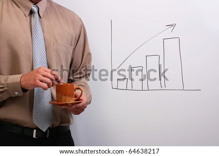 Man in a shirt and a tie holding a plate and a cup while standing next to a drawing of a bar graph. - stock photo