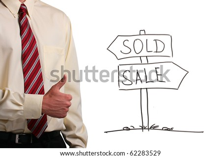 Man in a shirt and a tie showing thumbs up while standing next to a drawing of a sign. - stock photo