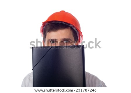 Man in a shirt in orange construction helmet covers his face black folder and smiling; isolate background - stock photo