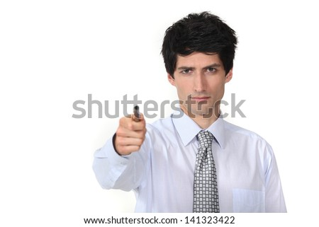 man in a suit holding a pen - stock photo