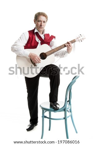 man in a suit playing acoustic guitar isolated on white background