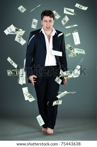 man in a suit throws money - stock photo